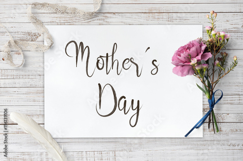 Valokuva  Mother´s Day - calligraphy and decorative items on wooden board