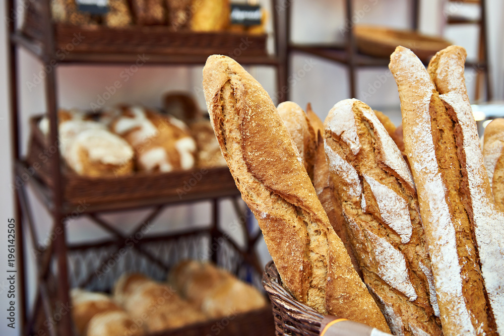 Bread baguettes in basket at baking shop