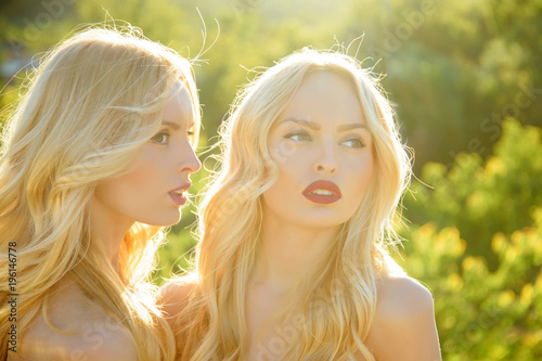 Photo  Twins in summer sunny weather.