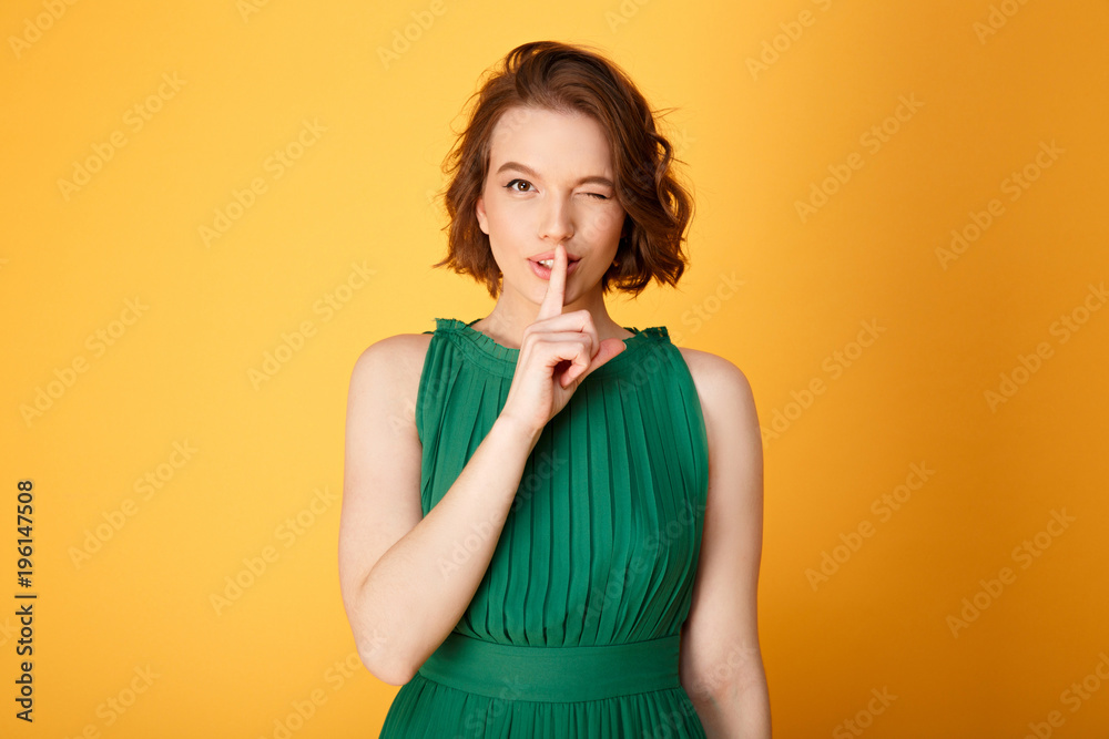 Fototapety, obrazy: portrait of attractive woman showing silence sign isolated on orange
