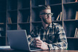 Leader freelance coworking networking job work browsing to-go people lifestyle concept. Portrait of dreamy pensive handsome minded creative worker wearing casual checkered shirt sitting at desktop