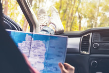 Young Woman Car Traveler With Map.