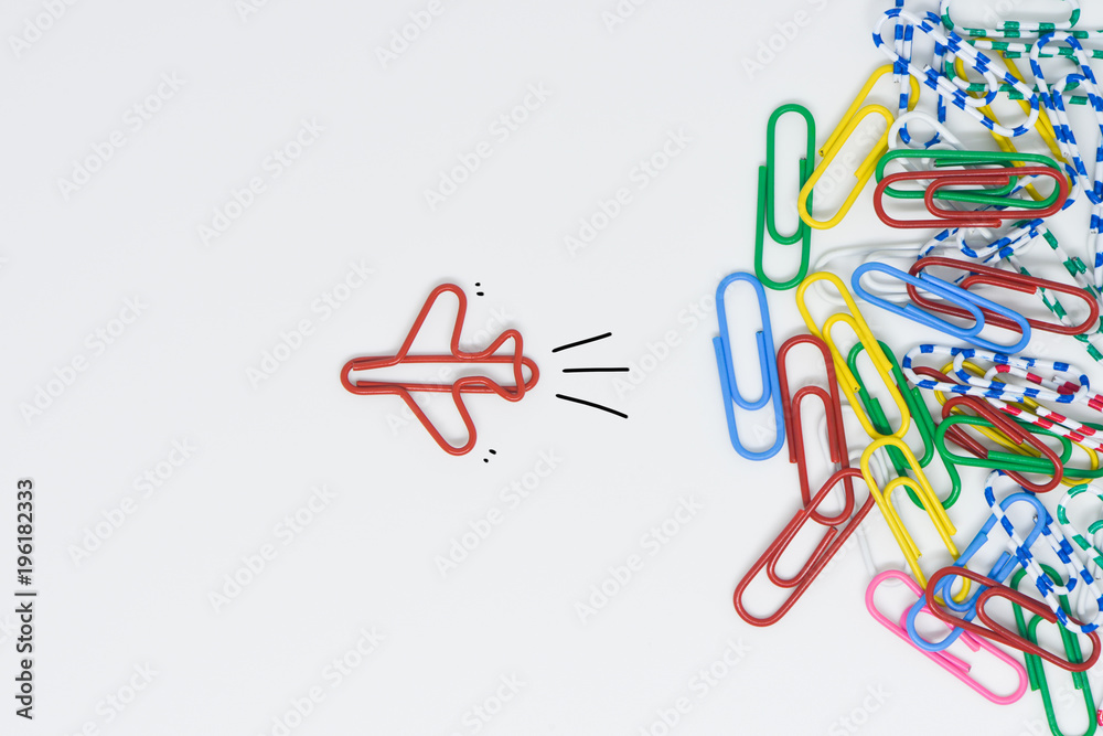 Fototapety, obrazy: Business concept for group of stacked paperclip with another one red plane paperclip is point to another direction as a team leadership