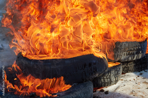 Fotografiet  burnt car wheel, car accident, wheel in the fire, burnt tires, burning tires for