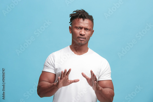 Young afro-american man with disgusted expression repulsing something, isolated Tapéta, Fotótapéta