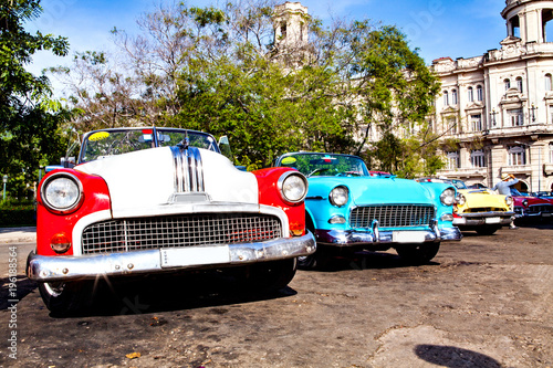 Group of colorful vintage classic cars parked in Old Havana Canvas Print