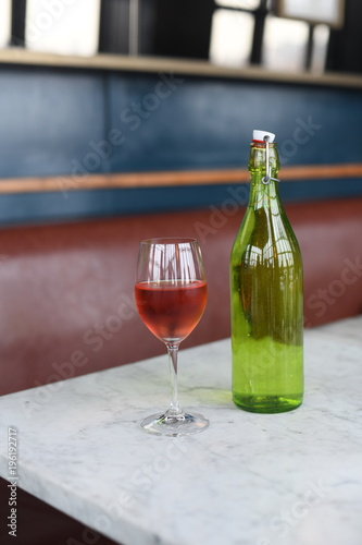 Tuinposter Wijn Rose wine and wine bottle with water