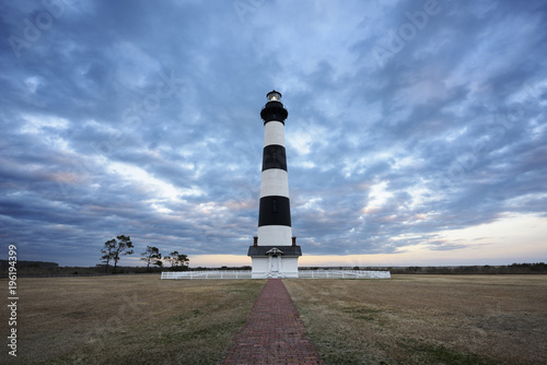 Fotografie, Obraz  Dramatic Sunset Sky at Lighthouse - Cape Hatteras National Seashore