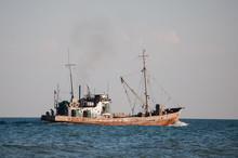 The Tugboat Sails On The Sea.