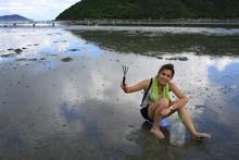 Clam Digging On Mud Beach In L...