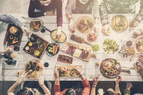 Group of people having meal togetherness dining Canvas Print