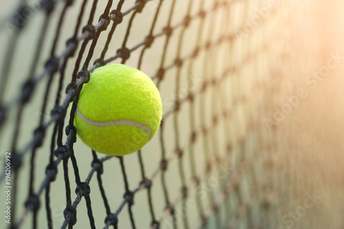 Fotomural Close up tennis ball hitting to net on blur background