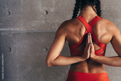 Fotografie, Obraz  Close up fit woman with arms behind back doing stretching exercises