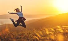 Happy Woman Jumping And Enjoyi...