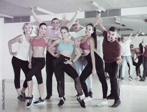 people posing in fitness studio