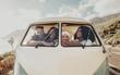 canvas print picture - Group of friends on roadtrip sitting inside minivan