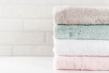 Spa Relax And Bath Concept, Stack Clean Bath Towels Colorful Cotton Terry Textile In Bathroom White Background, Copy Space Top View
