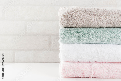 Fotografie, Obraz  Spa relax and bath concept, stack clean bath towels colorful cotton terry textil