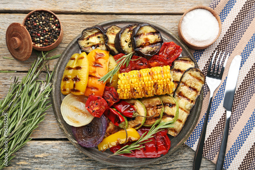 Deurstickers Grill / Barbecue Grilled vegetable on brown cutting board with rosemary, salt and pepper