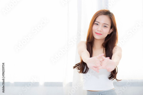 Fotografie, Obraz  Beautiful young asian woman stretch and relax in bed after wake up morning at bedroom, new day and resting for wellness, lifestyle concept