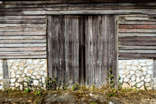 Background Of The Old Wooden Window With Old Stone And Wooden Wall In Thai House Styles