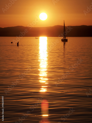 Photo  sunset over  lake Balaton near Siofok in Hungary