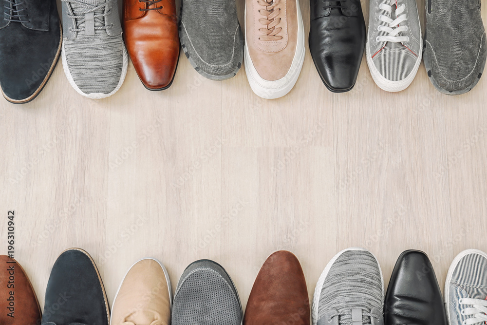 Fototapety, obrazy: Different male shoes on wooden floor