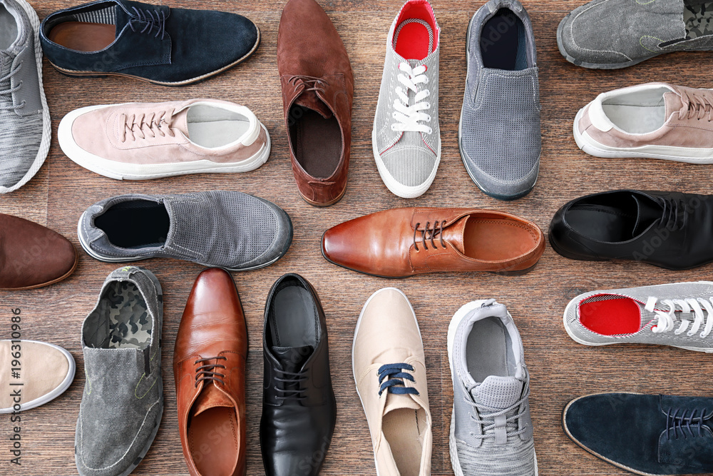 Fototapeta Different male shoes on wooden floor