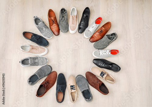 Frame made of different male shoes on wooden background