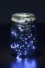 Glass Jar With Garland Inside