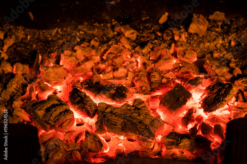 Fotografie, Obraz  Photo of hot sparking live-coals burning in a barbecue.