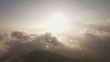 aerial shot of sunrise over the mountain with rain cloudy sky