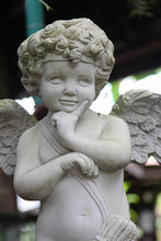 White Vintage Statue Cupid In ...