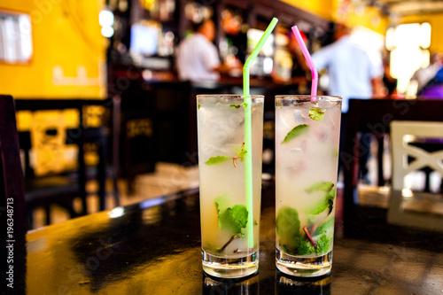 Photo Stands Havana Mojito cocktail in a bar in Cuba / Havana