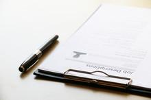 Job Description Paper On Table...