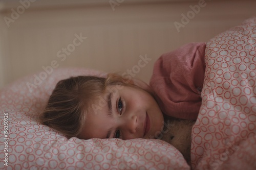 Girl sleeping on bed in bedroom at home