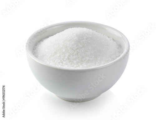 white sugar in white bowl on white background