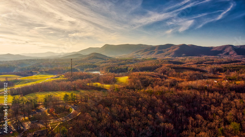 Poster Diepbruine Yellow sunset in Virginia mountains with clouds
