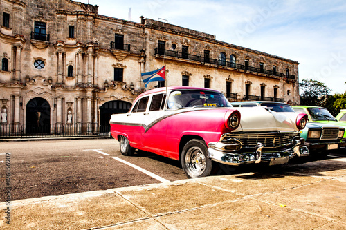 Fotografija  Group of colorful vintage classic cars parked in Old Havana