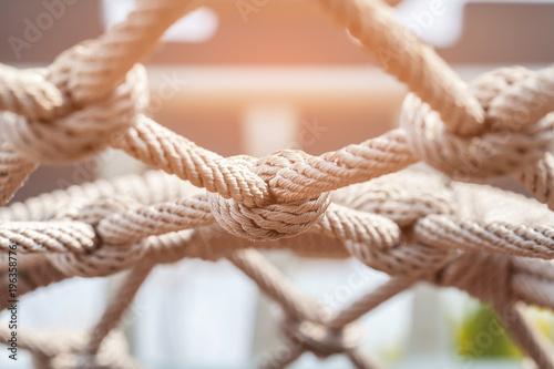 Obraz Close-up of rope knot line tied together with playground background.selective focus. - fototapety do salonu