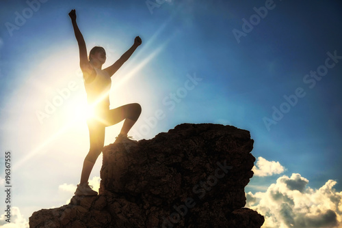 sport woman raise hands at mountain summit