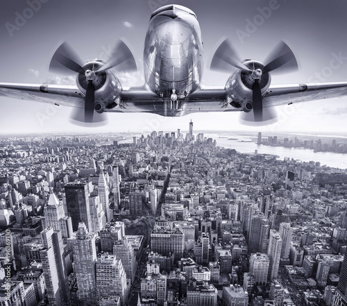 Photo historic aircraft in the sky over manhattan