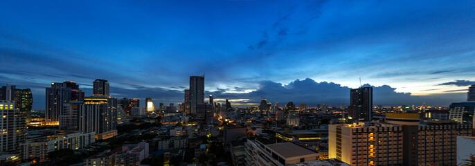Fototapeta panorama of urban metropolitan cityscape in twilight sunset sky
