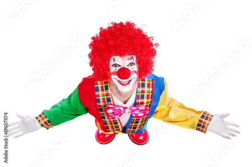 Top view of a happy clown  in a white studio