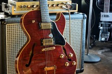 Semi Acoustic Electric Guitar With Tube Amp Studio Background