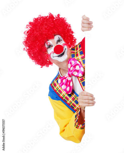 Happy clown holding blank board isolated on white background