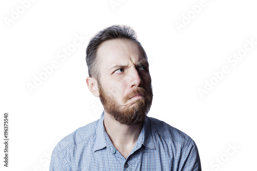 Face of an pensive and insult male on a white background. фототапет