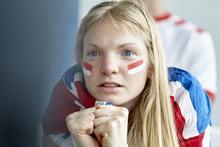 British Football Supporter Watching Match Indoors