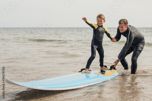 Surfing with Dad at the Beach