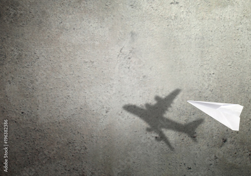 Paper plane shadow concept Wallpaper Mural